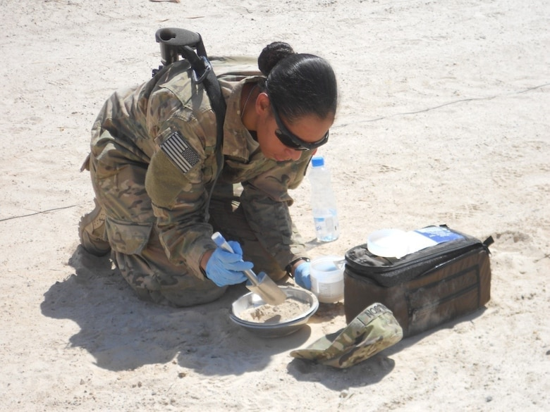 A Soldier inspects a soil sample at Camp Al Taqaddum, Iraq. U.S. forces are readily deployable to anywhere on the planet and have the capability to set up operations under very harsh conditions to meet the required objectives. A set of environmental guidelines is followed to minimize initial impact and alternatives that are more protective of human health and the environment are constantly implemented as operations transition from initial deployment into sustainment.