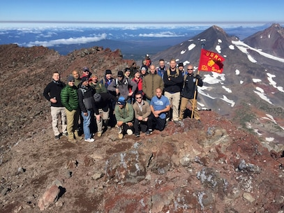 Marines from Recruiting Station Portland pose for a picture at the peak of Three Sisters, a complex of three volcanic peaks of the Cascade Volcanic Arc and the Cascade Mountain Range of Oregon. The highest peak of Three Sisters is 10,358 feet and it experiences frequent snow and occasional rainfall, with extreme temperature differences between seasons. (Photo Courtesy of the RS Portland SgtMaj Facebook Page)