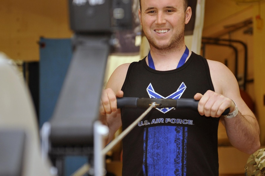 U.S. Air Force Senior Airman, Scott Brown, reaches deep as he pulls back in the rowing exercise. Wounded warriors members from across the country participated in a special camp focused on recovery. More than 120 participated in hopes to aid with their healing process with events like archery, swimming, basketball and more at Offutt Air Force Base, Nebraska, Sept. 17 - 23. (U.S. Air Force photo by Jeff W. Gates)