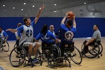 Wounded Warriors play seated basketball in the Offutt Field House at Offutt Air Force Base, Neb., Sept. 21, 2016. The base hosted a four day long training camp for wounded warriors to train in preparation for their yearly competition in June. (U.S. Air Force photo by Zachary Hada)