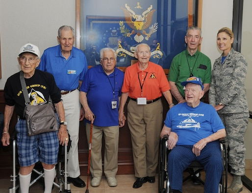 Col. April Vogel, right, commander of the 6th Air Mobility Wing, pauses for a photo with veterans of the 6th Bombardment Group (BG) at MacDill Air Force Base, Fla., Sept. 23, 2016. The 6th BG, conducted bombing raids over Japan during WWII, and is the predecessor to the 6th Operations Group at MacDill. (U.S. Air Force photo by Airman Adam R. Shanks)