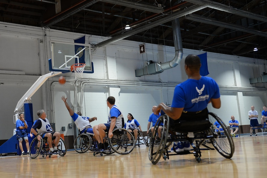 Wounded Warrior Nate Bias tries to intercept a ball during seated basketball in the Offutt Field House at Offutt Air Force Base, Neb., Sept. 21, 2016 during Air Force wounded warrior training. The Wounded Warrior event had 120 current and former Air Force members from across the country participate in sports. (U.S. Air Force photo by Zachary Hada)