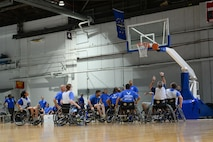 Wounded Warriors play seated basketball in the Offutt Field House at Offutt Air Force Base, Neb., Sept. 21, 2016. Wounded warriors is an adaptive sports competition for wounded, ill and injured service members and veterans. (U.S. Air Force photo by Zachary Hada)