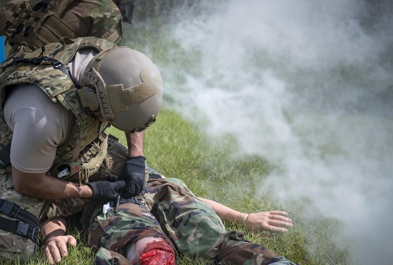 U.S. Air Force Tech. Sgt. Jose Obregon, 347th Operations Support Squadron independent duty medical technician-paramedic, applies a tourniquet to a simulated patient during a tactical combat casualty care course, Sept. 22, 2016, in Okeechobee, Fla. In order to simulate realistic human flesh, the instructors used pork meat and fake blood in conjunction with the mannequins. (U.S. Air Force photo by Staff Sgt. Ryan Callaghan)