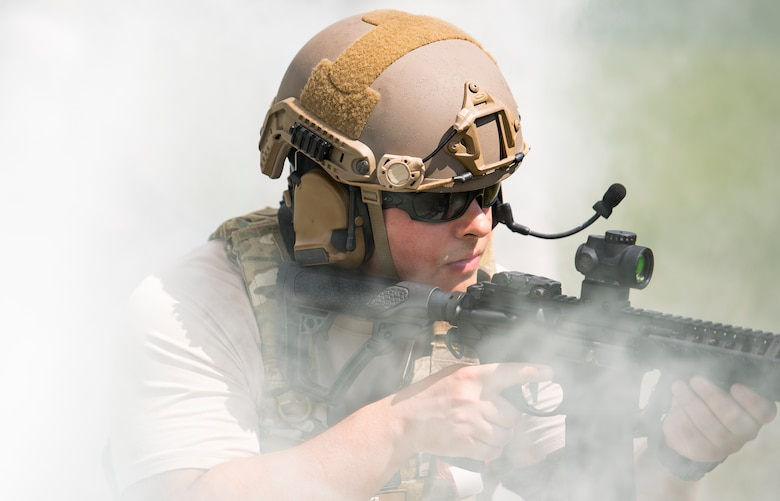 U.S. Air Force Senior Airman Michael Triana, 347th Operations Support Squadron independent duty medical technician-paramedic, looks for targets while providing security for his team during a tactical combat casualty care course, Sept. 22, 2016, in Okeechobee, Fla. During the scenario, the fire team secured the area, found the patient, provided care while under fire, and finally, extracted the patient. (U.S. Air Force photo by Staff Sgt. Ryan Callaghan)
