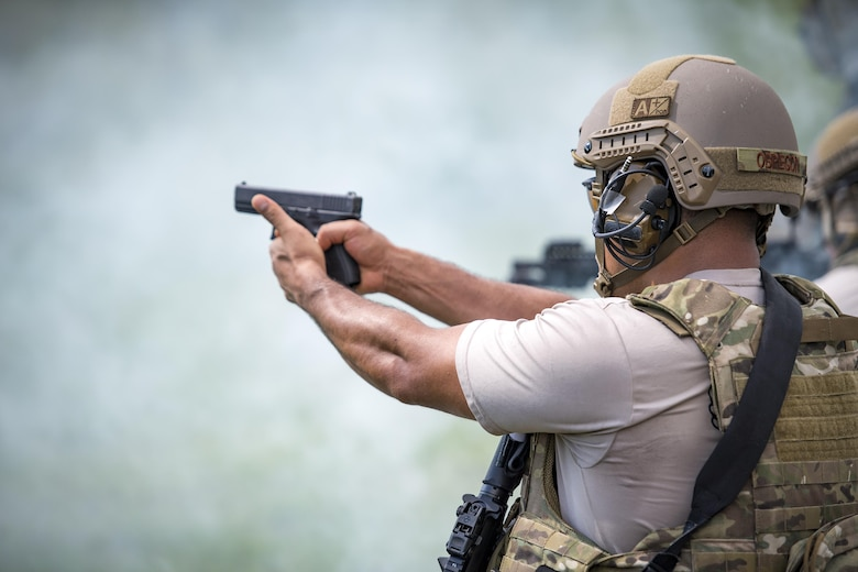 U.S. Air Force Tech. Sgt. Jose Obregon, 347th Operations Support Squadron independent duty medical technician-paramedic, moves through a scenario during a tactical combat casualty care course, Sept. 22, 2016, in Okeechobee, Fla. TCCC culminated with a large-scale 'active-shooter' event, which required the participants to clear a large area of threats and evacuate multiple patients. (U.S. Air Force photo by Staff Sgt. Ryan Callaghan)