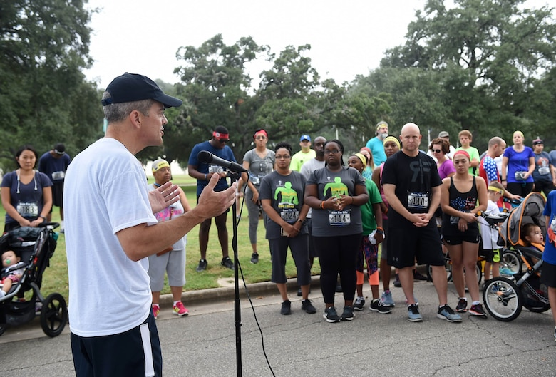 Brig. Gen. John DeGoes, 59th Medical Wing vice commander, gives opening remarks at the 4th Annual 5K Run for Life event at Heritage Park on Joint Base San Antonio-Randolph, Texas, Sept. 24, 2016. Hosted by the 59th Medical Wing, the event coincides with National Suicide Prevention month. (U.S. Air Force photo/Staff Sgt. Jerilyn Quintanilla)