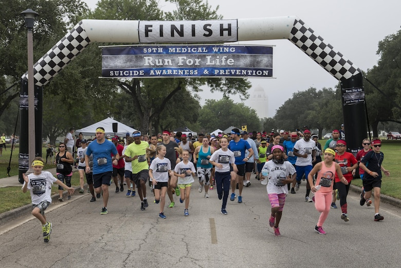 Runners who are participating in the 4th Annual 5K Run for Life event take off from the starting line at Heritage Park on Joint Base San Antonio-Randolph, Texas, Sept. 24, 2016. Nearly 260 Airmen, civilians and their families participated in the event, which was sponsored by the 59th Medical Wing. (U.S. Air Force photo/Senior Airman Stormy Archer)