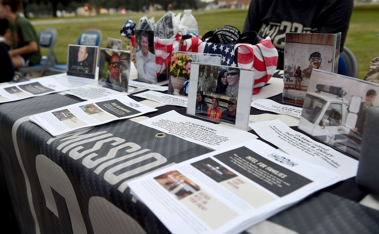 Photos and flyers from the Mission 22 organization are displayed at the 4th Annual Run for Life 5k event on Joint Base San Antonio-Randolph, Texas, Sept. 24, 2016. According to the Mission 22 website, roughly 22 combat veterans commit suicide every day. The organization spreads awareness and acts as a support resource for veterans and their families. (U.S. Air Force photo/Staff Sgt. Jerilyn Quintanilla)