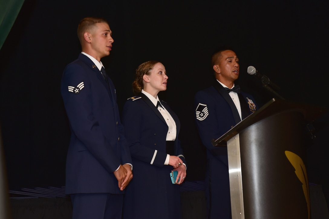 The 2nd Space Warning Squadron choir sings the National Anthem during a senior NCO induction ceremony Sept. 23, 2016, Heritage Eagle Bend Golf Course in Aurora, Colo. The ceremony is a long-standing Air Force tradition that recognizes enlisted service members who have reached the rank of master sergeant. (U.S. Air Force photo by Airman 1st Class Gabrielle Spradling/Released)