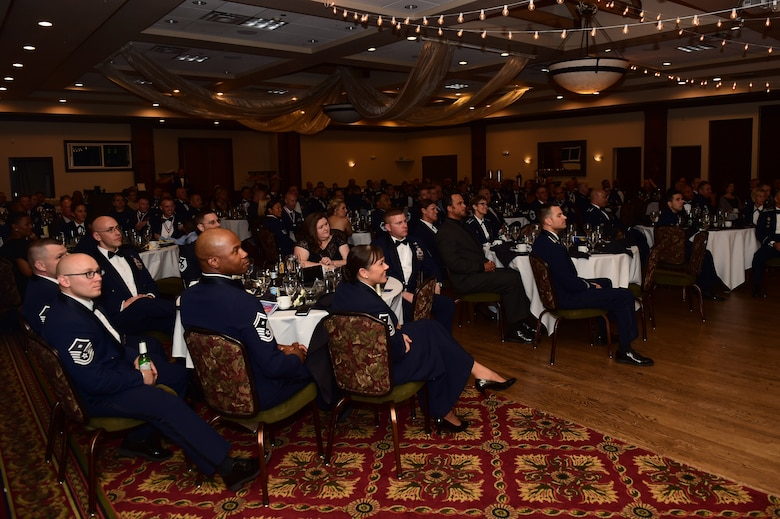 """Team Buckley listens to former Chief Master Sgt. of the Air Force Frederick J. """"Jim"""" Finch speak during a senior NCO induction ceremony Sept. 23, 2016, Heritage Eagle Bend Golf Course in Aurora, Colo. The ceremony is a long-standing Air Force tradition that recognizes those who have reached the rank of master sergeant. (U.S. Air Force photo by Airman 1st Class Gabrielle Spradling/Released)"""