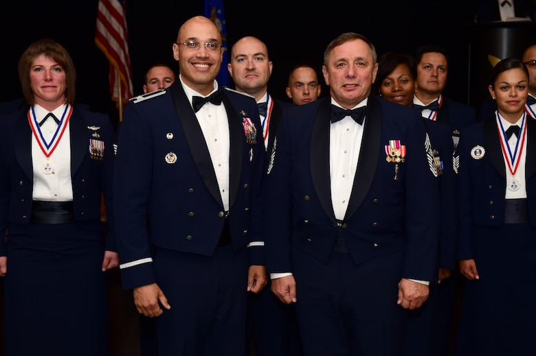 """Col. David Miller Jr., 460th Space Wing commander, and former Chief Master Sgt. of the Air Force Frederick J. """"Jim"""" Finch stand together during a senior NCO induction ceremony Sept. 23, 2016, Heritage Eagle Bend Golf Course in Aurora, Colo. Finch spent the day mentoring not only Buckley's newest SNCO's, but also members from all ranks. (U.S. Air Force photo by Airman 1st Class Gabrielle Spradling/Released)"""