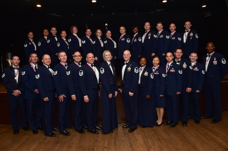 Buckley Air Force Base's newest senior NCO's stand together after an induction ceremony Sept. 23, 2016, Heritage Eagle Bend Golf Course in Aurora, Colo. The ceremony is a long-standing Air Force tradition that recognizes those who have reached the rank of master sergeant. (U.S. Air Force photo by Airman 1st Class Gabrielle Spradling/Released)