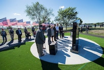 Marine Corps Gen. Joe Dunford, center, chairman of the Joint Chiefs of Staff, helps unveil the new Gold Star Families Memorial Monument in Fall River, Mass., Sept. 25, 2016. The memorial is a tribute to the Massachusetts families who lost loved ones in military service to the country. DoD Photo by Navy Petty Officer 2nd Class Dominique A. Pineiro