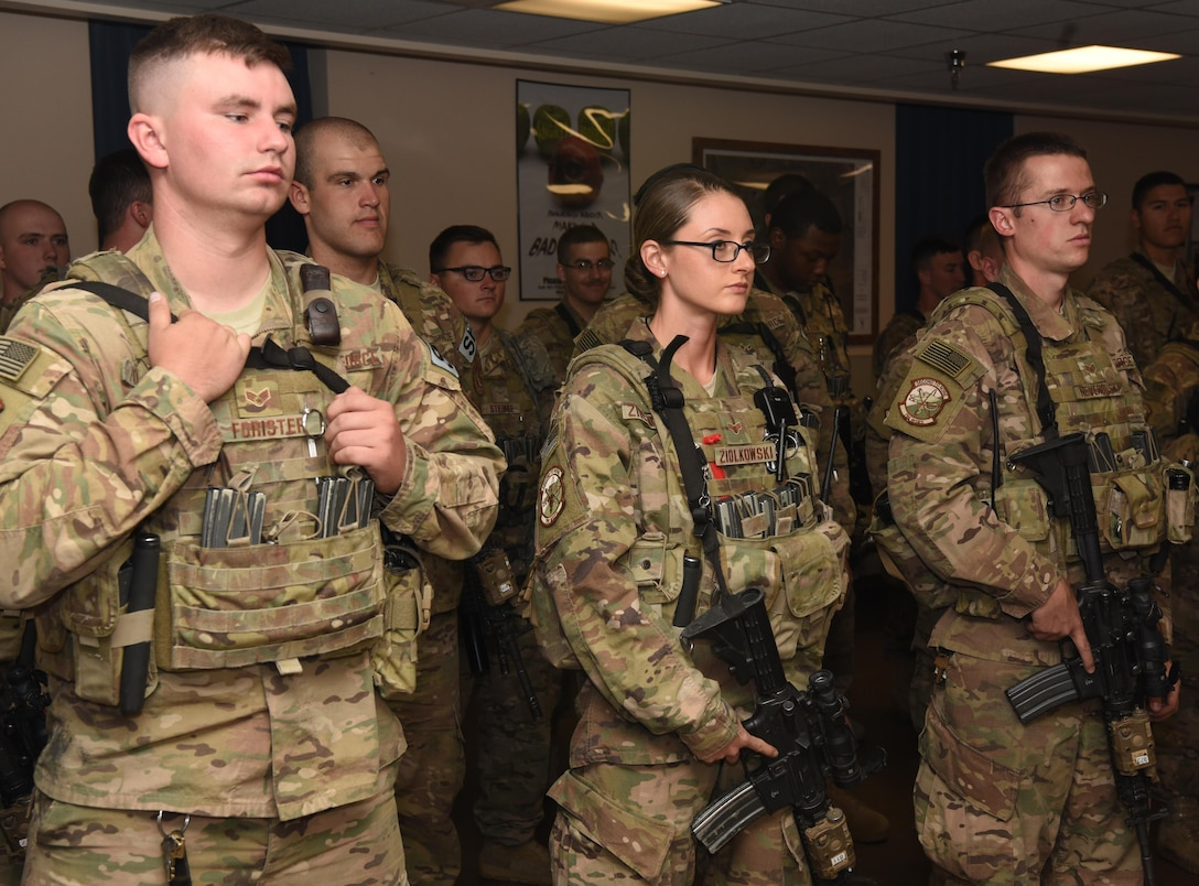 Senior Airman Brianna Ziolkowski, 790th Missile Security Forces Squadron security support team response force leader, receives a briefing during guard mount at F.E. Warren Air Force Base, Wyo., Sept. 16, 2016. During guard mount, defenders checked their equipment, conducted roll call and received their post assignments.