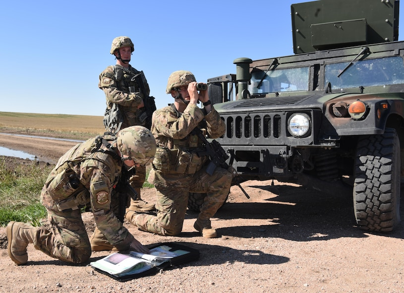 Airmen with the 790th Missile Security Forces Squadron security support team response force look over their tactical assault response plan and monitor avenues of approach at a 90th Missile Wing launch facility Sept. 16, 2016. The security support team had to remain within a five-minute response time to the affected site.