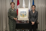 "Gen. Lori Robinson, Commander of NORAD and USNORTHCOM, accepts the original NORAD emblem artwork from Ms. Mona Rowe, daughter of the late Mr. Paul Jaffe, designer of the original emblem at the North American Aerospace Defense Command and U.S. Northern Command Headquarters in Colorado Springs, Colo., Sept. 23, 2016.  In honor of her father, Rowe donated his artwork to the commands.  ""My father's work resides with family,"" Rowe said."
