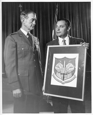 Mr. Paul Jaffe (right), the designer of the original North American Aerospace Defense Command emblem, shows his artwork to Gen. Earle E. Partridge, first commander of NORAD, in approximately 1957.  NORAD was formally established in 1958.  Jaffe's daughter, Ms. Mona Rowe, donated her late father's original artwork of the emblem to the command at the NORAD and U.S. Northern Command Headquarters in Colorado Springs, Colo., Sept. 23, 2016.  (Jaffe Family Courtesy Photo)