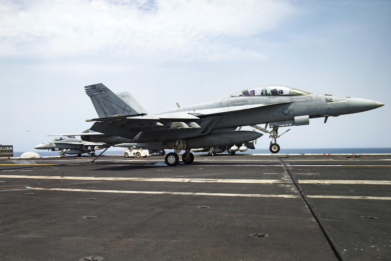 An F/A-18F Super Hornet assigned to Strike Fighter Squadron 32 makes an arrested landing on the flight deck of the aircraft carrier USS Dwight D. Eisenhower in the Gulf of Aden, July 14, 2016. The Eisenhower and its Carrier Strike Group are supporting Operation Inherent Resolve, maritime security operations and theater security cooperation efforts in the U.S. 5th Fleet area of operations. Navy photo by Petty Officer 3rd Class Anderson W. Branch