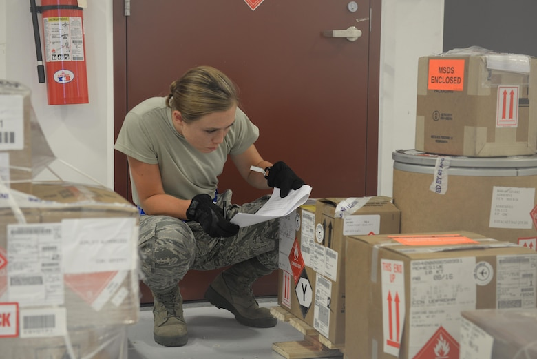 Airman 1st Class Adria Brown, 734th Air Mobility Squadron aircraft services technician, verifies incoming cargo Sept. 7, 2016, at Andersen Air Force Base, Guam. The 734th AMS, a tenant unit from Air Mobility Command, supports the 36th Wing's mission of projecting airpower by transporting essential material to and from Andersen AFB or for humanitarian response. (U.S. Air Force photo by Airman 1st Class Jacob Skovo)