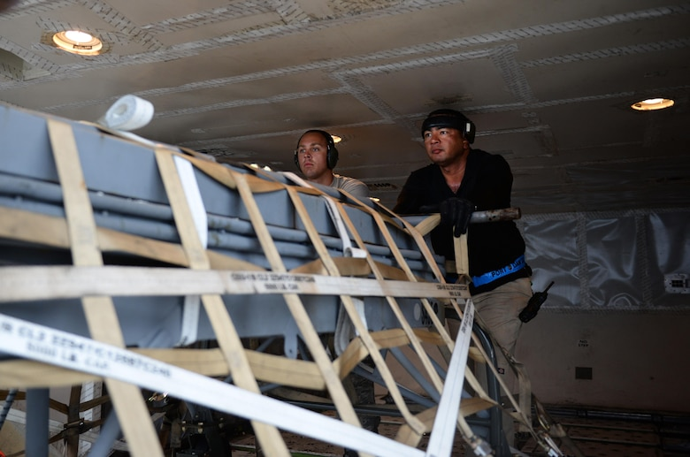 Airman 1st Class Matthew Carpenter, left, 44th Air Maintenance Unit crew chief, and Fred San Nicolas, 734th Air Mobility Squadron load team chief, push an aircraft pallet Sept. 7, 2016, at Andersen Air Force Base, Guam. The 734th provides high velocity transportation of equipment, household goods, weapon systems and other essential cargo. (U.S. Air Force photo by Airman 1st Class Jacob Skovo)