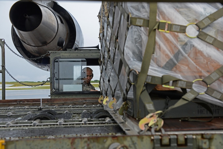 Kevin Mesa, 734th Air Mobility Squadron air freight service technician, operates a Tunner 60K aircraft cargo loader Sept. 7, 2016, at Andersen Air Force Base, Guam. The Tunner 60K aircraft cargo loader is capable of transporting up to six cargo pallets at a maximum speed of 23 mph. The vehicle's deck elevates from 39 inches to 18 feet 6 inches high and employs a powered conveyor system to move cargo. (U.S. Air Force photo by Airman 1st Class Jacob Skovo)