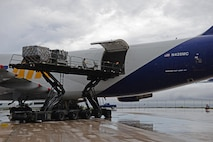 Airmen from the 734th Air Mobility Squadron unload a Boeing 747 onto a Tunner 60K aircraft cargo loader Sept. 7, 2016, at Andersen Air Force Base, Guam. The Tunner 60K aircraft cargo loader is capable of transporting up to six cargo pallets at a maximum speed of 23 mph. The vehicles deck elevates from 39 inches to 18 feet 6 inches high and employs a powered conveyor system to move cargo. (U.S. Air Force photo by Airman 1st Class Jacob Skovo)