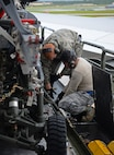 Staff Sgt. Vincent Lim, 734th Aircraft Mobility Squadron load team chief, and Airman Zachary Puerner, left, 734th AMS aircraft services technician, tie down cargo on a Tunner 60K aircraft cargo loader Sept. 7, 2016, at Andersen Air Force Base, Guam. The 734th AMS provides the capability to move cargo, personnel and equipment at a high velocity, ensuring Andersen AFB is prepared to meet mission requirements.(U.S. Air Force photo by Airman 1st Class Jacob Skovo)