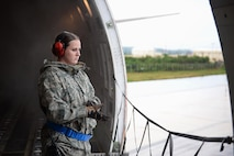 Senior Airman Hannah Stewart, 734th Air Mobility Squadron aircraft services technician, waits for an aircraft cargo loader Sept. 7, 2016, at Andersen Air Force Base, Guam. The 734th AMS provides humanitarian relief and rapid response capabilities in the event of a natural disaster within the Indo-Asia-Pacific region. (U.S. Air Force photo by Airman 1st Class Jacob Skovo)