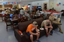 Servicemembers unwind in USO Incirlik after its grand opening ceremony Sept. 23, 2016, at Incirlik Air Base, Turkey. USO Incirlik is open Sunday through Thursday from 10 a.m. to 11 p.m., and Friday and Saturday from 10 to 1 a.m. (U.S. Air Force photo by Senior Airman John Nieves Camacho)