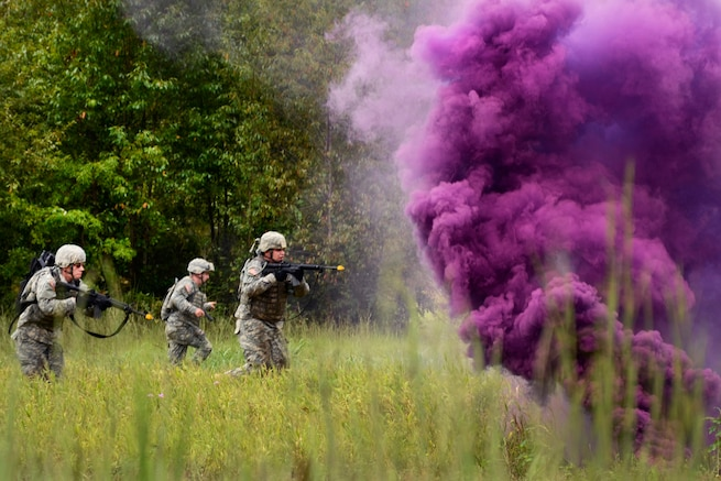 Soldiers advance under the cover of smoke to assault an objective during training at McCrady Training Center in Eastover, S.C., Sept. 20, 2016. Army National Guard photo by 1st Lt. Jessica Donnelly
