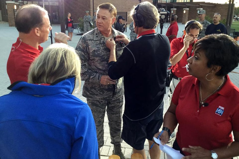 Air Force District of Washington commander Maj. Gen. Darryl Burke speaks with Fox 5 DC at the Jones building live at Joint Base Andrews on Sep. 23, 2016. AFDW hosted Fox5 DC for a live broadcast of FOX 5 News Morning and Good Day DC live from JBA in celebration of the Air Force's 69th Birthday. (U.S. Air Force photo/Tech. Sgt. Matt Davis)