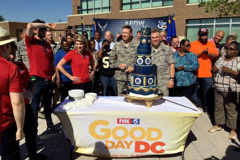 Air Force District of Washington Commander Maj. Gen. Darryl Burke and AFDW Command Chief Master Sgt. Tommy Mazzone celebrate the United States Air Force's 69th birthday with the Fox 5 DC team at Joint Base Andrews on Sep. 23, 2016. AFDW hosted Fox5 DC for a live broadcast of FOX 5 News Morning and Good Day DC live from JBA in celebration of the Air Force's 69th Birthday. (U.S. Air Force photo/Tech. Sgt. Matt Davis)