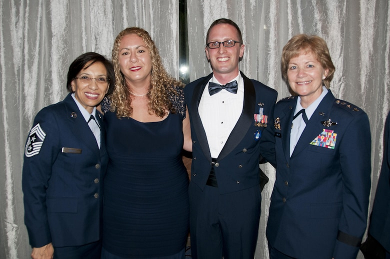 From left: Air Force Reserve Command Chief Master Sgt. Ericka Kelly, Mrs. Natalie Tolber, Staff Sgt. Aaron Tobler, Lt. Gen. Maryanne Miller, chief of the Air Force Reserve and commander, Air Force Reserve Command, during the Air Force Association recognition banquet for the 12 Outstanding Airmen of  the Year Sept. 19, 2016. Tobler is a geospatial intelligence analyst with the 50th Intelligence Squadron, Beale Air Force Base, California.