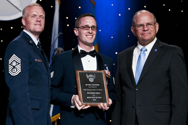 Staff Sgt. Aaron Tobler, center, with Chief Master Sgt of the Air Force James Cody and Scott Van Cleef, Air Force Association Chairman of the Board, during the AFA's recognition banquet in Washington, D.C., honoring the Air Force's 12 Outstanding Airmen of the Year, Sept. 19, 2016.  Tobler is a geospatial intelligence analyst with the 50th Intelligence Squadron, Beale Air Force Base, California. The 50th IS is a classic associate intelligence unit under the 655th Intelligence, Surveillance and Reconnaissance Group, Wright-Patterson AFB, Ohio.