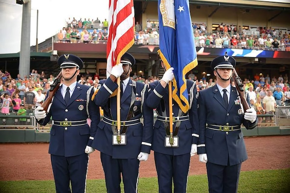 Members of the Wright-Patterson Air Force Base Honor Guard perform at a Dayton Dragons baseball game earlier this year. Senior Airman Joseph Divish, far right, is a Citizen Airman in the 87th Aerial Port Squadron. (Courtesy photo)