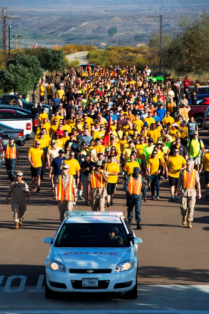 Marines and Sailors follow the pace car at the start of the 2nd annual Suicide Awareness and Prevention Walk aboard Camp Pendleton, Calif., Sept. 23, 2016. The walk was held to increase awareness about suicide and highlight the resources available to help those in need. (U.S. Marine Corps photo by Sgt. Abbey Perria)