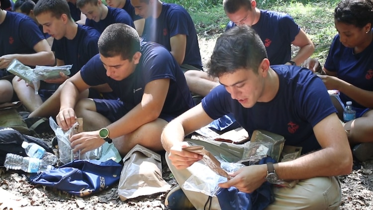 U.S. Marine applicants in the Delayed Entry Program observe the contents of their Meal-Ready-To-Eat during a break from a hike Aug. 20 at Sugarloaf Mountain in Urbana, Maryland. The applicants, from Recruiting Sub-station Rockville, Recruiting Station Frederick, were also given two bottles of water and a sports drink to get through the 3.31-mile hike. (Official U.S. Marine Corps Photo by Sgt. Anthony J. Kirby/Released)