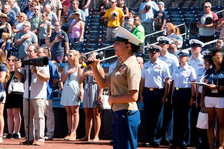 Private First Class Senora Lyons, a company clerk with Headquarters Company, Headquarters Regiment, 1st Marine Logistics Group, sings the National Anthem, Sept. 25, 2016, at Petco Park, San Diego, Calif. Around 28,400 spectators stood and sang with Lyons at the San Diego Padres vs. the San Francisco Giants baseball game. Servicemembers from the Navy, Coast Guard and Marine Corps performed during the opening ceremony and at the 7th inning stretch. (U.S. Marine Corps photo by Lance Cpl. Adam Dublinske)