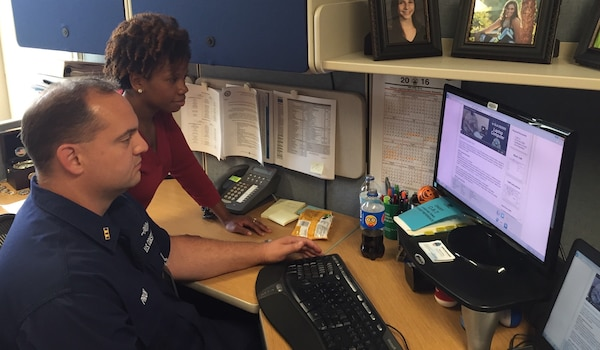 Defense Logistics Agency employee Angela Patterson (left) and Coast Guard Chief Warrant Officer Marcus Pryor (right) view the new Digital DSR tool.