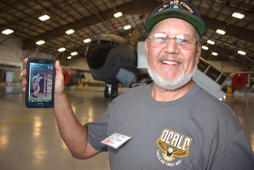 "Jeff Van Dorp showcases a photo of himself, Airman Van Dorp from 1975 at the ""SH Okie"" reunion Sept. 23 in the 507th Air Refueling Wing Hangar 1030. Van Dorp served in the Aerial Repair and Isochronal Inspection shop in the wing from 1981-2008 and currently works in maintenance in the Air Logistics Center as a civil service civilian. (U.S. Air Force Photo/Maj. Jon Quinlan)"
