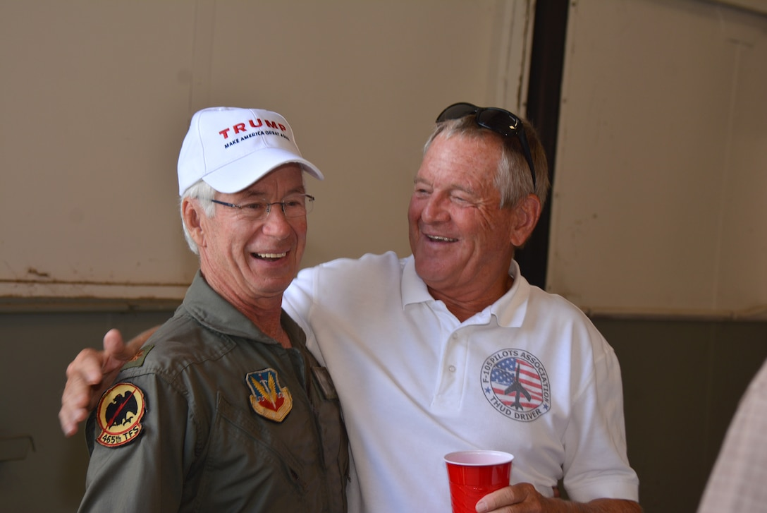"Bob Klabzuba and Tom ""Waldo"" King meet and share stories during the ""SH Okie"" reunion Sept. 23 at the 507th Air Refueling Wing Hangar 1030.  Both men served as fighter pilots in the 465th Tactical Fighter Squadron.  (U.S. Air Force Photo/Maj. Jon Quinlan)"
