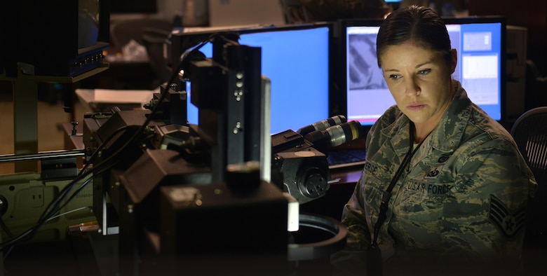 Staff Sgt. Renee, 9IS geospatial analyst, reviews duplicate film June 15, 2016, at Beale Air Force Base, California. Once developed, Optical Bar Camera film is given to geospatial analysts for evaluation. The GA section is responsible for creating cohesive imagery products for combatant commanders. (Air Force photo by Airman 1st Class Taylor A. Workman)