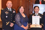 Army Capt. Miracle Garcia has been honored with the 2016 National Image Inc. Award for Meritorious Military Service. Garcia (right) was joined by her supervisor from DLA Land and Maritime Col. Yee Hang (left) at the Sept. 15. ceremony in Albuquerque, N.M., hosted by National Image Inc. president and CEO Sylvia Chavez-Metoyer (middle).
