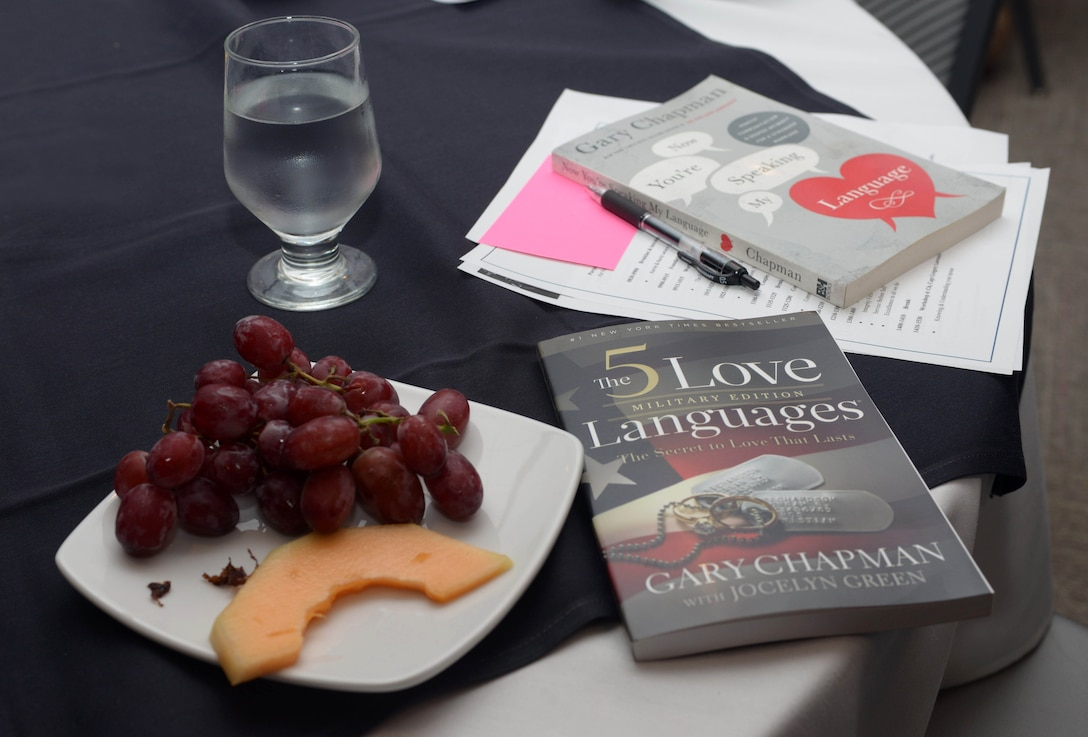 """Couples were provided books and materials focused on love languages and communication during a """"Mil-to-Mil"""" Workshop held at the Rushmore Hotel in Rapid City Sept. 23, 2016. At the event, couples from Ellsworth Air Force Base, S.D., learned about the five love languages, the foundation of communication, trust and respect, stress management and mentorship. (U.S. Air Force photo by Airman 1st Class Donald C. Knechtel)"""