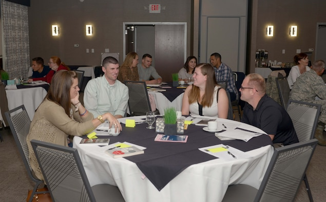Couples from Ellsworth Air Force Base, S.D., converse amongst one another at the Rushmore Hotel in Rapid City, Sept. 23, 2016. Military couples were given the opportunity to meet and discuss the various challenges they have gone through and how to overcome the difficulties. (U.S. Air Force photo by Airman 1st Class Donald C. Knechtel)