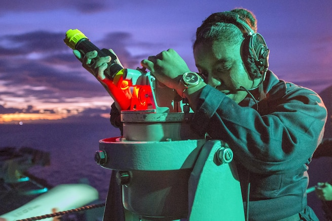 Navy Seaman Daija Anderson takes navigation readings on the USS Bonhomme Richard in the Philippine Sea, Sept. 26, 2016. The amphibious assault ship is supporting security and stability in the Indo-Asia Pacific region. Navy photo by Petty Officer 1st Class David Holmes