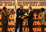"""Gen. Robert B. Brown, Commander, U.S. Army Pacific and Lt. Gen. Dato' Sri Zulkiple, Field Commander West, Malaysian Army present a memento to the Honorable Dato' Seri Hishmuddin, Minister of Defence Malaysia during the opening ceremony for PAMS 2016, in Kuala Lumpur, Malaysia, September 26. PAMS is an annual multinational military seminar providing a forum for senior level ground force officers from regional ground forces and security forces to meet, exchange views and discuss professional military subjects. This year's theme is """"Unity of Effort: Building Civil-Military Partnerships to Counter Violent Extremism."""" This seminar marks the 40th iteration of PAMS."""