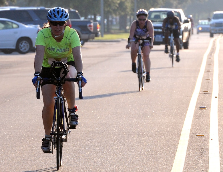 Maj. Jennifer Varney, 81st Medical Group doctor and nursing practice phase II site director, competes in the 9-mile bike course portion of Keesler's mini-triathlon Sept. 23, 2016, on Keesler Air Force Base, Miss. The event also included a 200-yard swim and a 2-mile run.