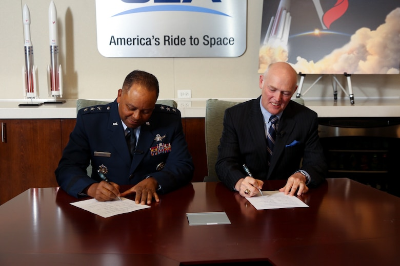 Lt. Gen. Samuel Greaves, Air Force program executive officer for Space and SMC commander, and Tory Bruno, ULA president and CEO, sign a Cooperative Research and Development Agreement or CRADA for the certification of ULA's Vulcan Launch System at a ceremony, Sept. 27. (Photo Courtesy of ULA)